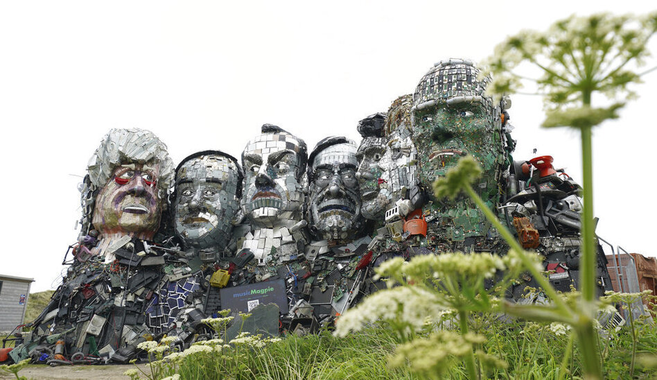 A sculpture created out of electronic waste in the likeness of Mount Rushmore and the G-7 leaders sits on a hill in Cornwall, England, near where the leaders of the world's wealthiest nations will meet. (Jon Super/AP)