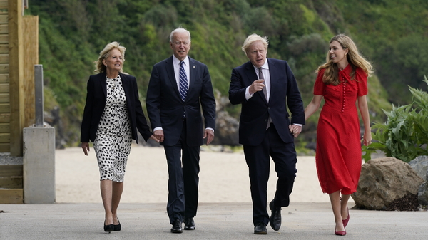 President Biden and first lady Jill Biden walk with British Prime Minister Boris Johnson and his wife Carrie Johnson in  Carbis Bay, England.