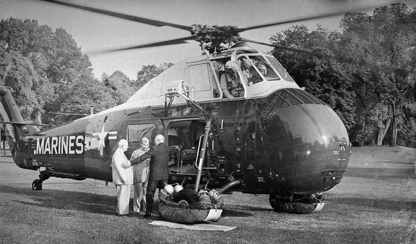 President Dwight Eisenhower and Soviet Premier Khrushchev prepare to board a helicopter at the White House for a flight to Camp David on Sept. 25, 1959.