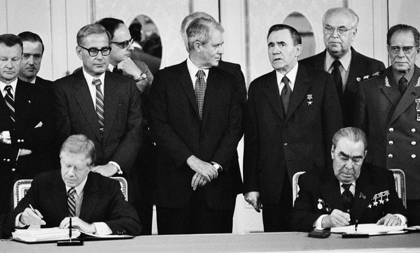 President Jimmy Carter (seated left) and Soviet President Leonid Brezhnev (seated right) sign the SALT II treaty on June 18, 1979, in Vienna, Austria.