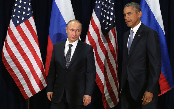 Russian President Vladimir Putin and President Barack Obama pose for photographs before the start of a bilateral meeting at the United Nations headquarters on Sept. 28, 2015, in New York City.