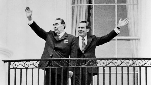 General Secretary of the Communist Party of the Soviet Union Leonid Brezhnev (left) and President Richard Nixon wave at the balcony of the White House on June 18, 1973.