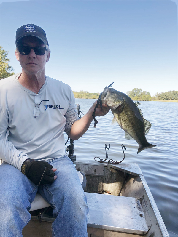 Mark Forrest is back fishing after rehabilitation with the IpsiHand device helped him regain use of his right hand.