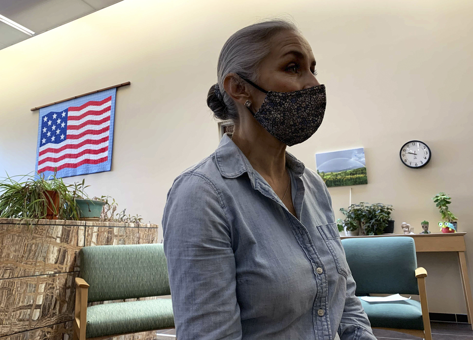 Christina Campos, administrator of the Guadalupe County Hospital, says the community has been hit with several large outbreaks of the virus, most recently in May, which has bolstered vaccination rates. (Kirk Siegler/NPR)