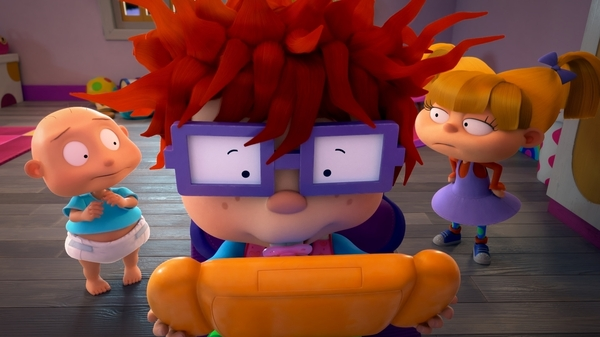 Pictured: Tommy Dewey as Stu Pickles, Nancy Cartwright as Chuckie Finster and Cheryl Chase as Anjelica Pickles of the Paramount+ series Rugrats.