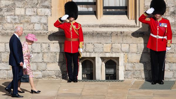 Queen Elizabeth II and President Biden walk at Windsor Castle on Sunday in Windsor, England. This is Biden
