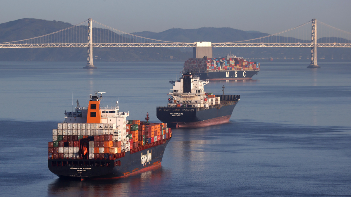 SAN FRANCISCO, CALIFORNIA - MARCH 26: Container ships sit idle in the the San Francisco Bay just outside of the Port of Oakland on March 26, 2021 in San Francisco, California.