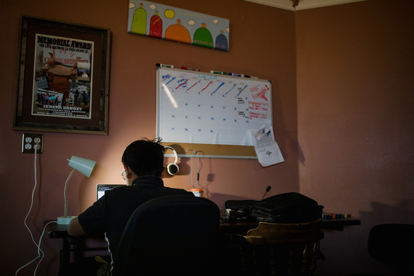 Domeniqu works on his computer at his home in Crownpoint.