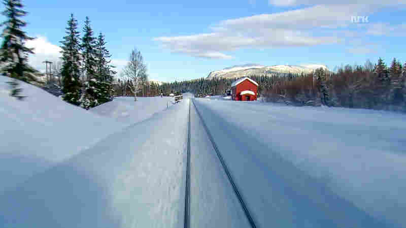"""A still from the Winter episode of """"Nordlandsbanen - Minutt for Minutt"""" produced by the Norwegian Broadcasting Corporation."""