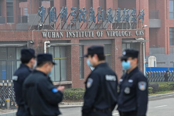 Security personnel stand guard outside the Wuhan Institute of Virology during the February 3 visit of the World Health Organization team investigating the origins of the SARS-CoV-2, the virus that triggered a pandemic.