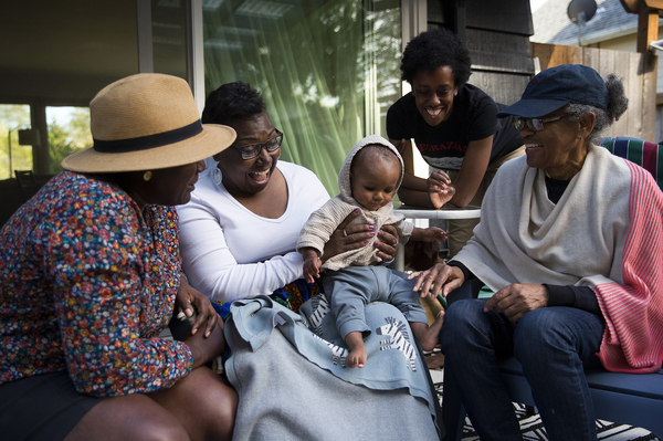 Cassandra Cast (second from  left) and Barbara Arthur (right) traveled to Washington state from Boston and Atlanta, respectively, to meet their grandson for the first time.