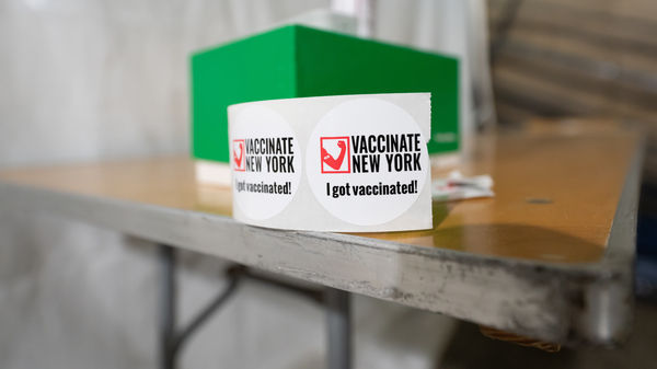 """A sticker reads, """"I got vaccinated,"""" at a vaccination site inside Penn Station last month in New York City."""