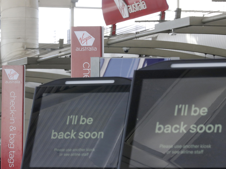 Virgin Australia was one of several major companies to be hit with technical issues Thursday that affected websites and mobile applications for airlines, banks and other corporations. (Rick Rycroft/AP)
