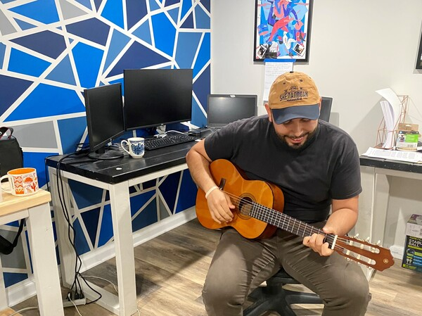 When he gets tired of looking at his screens, software developer Jonathan Caballero picks up a guitar he keeps next to his desk. Playing the guitar brought him cheer in the pandemic.