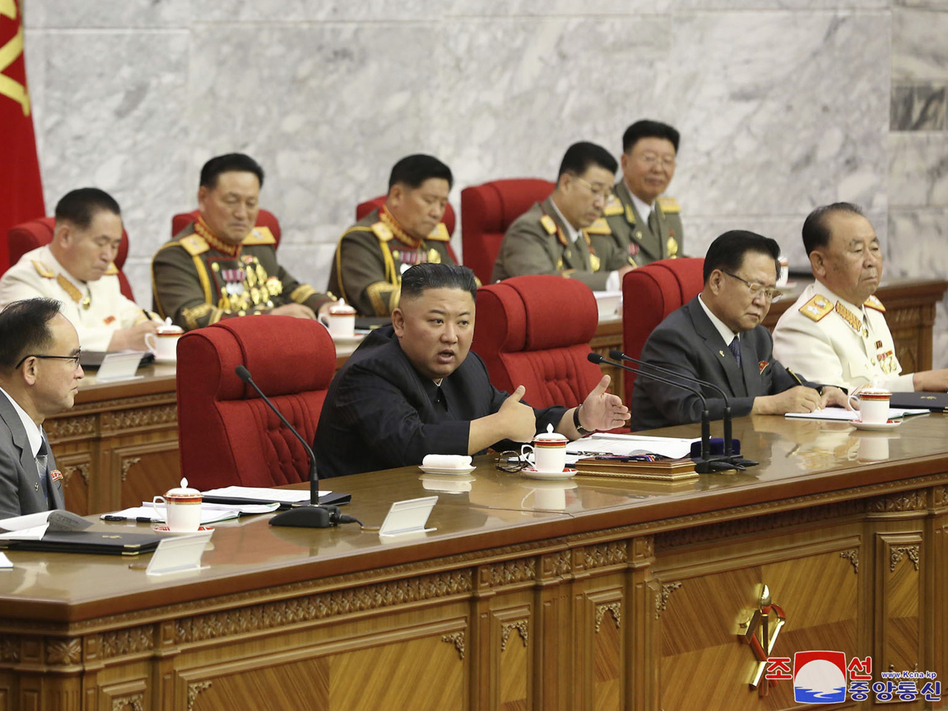 In this photo provided by the North Korean government, North Korean leader Kim Jong Un, center, speaks during a Workers' Party meeting Thursday in Pyongyang. Kim ordered his government to be fully prepared for confrontation with the Biden administration, state media reported Friday, days after the U.S. and other major powers urged the North to abandon its nuclear program and return to talks. (朝鮮通信社/AP)