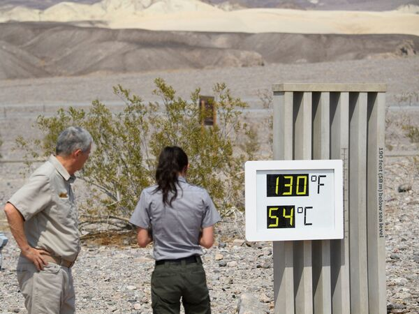 Visitors feel the heat in California's Death Valley earlier this week. This record-setting heat wave's remarkable power, reach and unusually early appearance is giving meteorologists yet more cause for concern about extreme weather in an era of climate change.