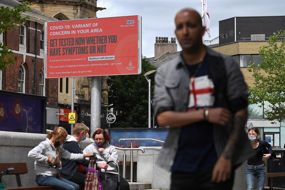 A sign urges people to get tested for a COVID-19 variant in Blackburn, England. The U.K. is experiencing a surge in the delta variant, which was first identified in India. (Oli Scarff/AFP via Getty Images)