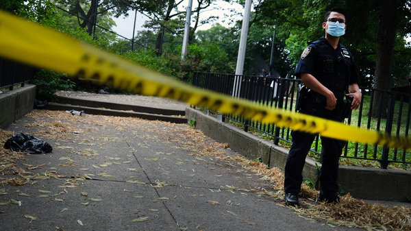 A police officer stands near the scene of a fatal afternoon shooting in Brooklyn borough of New York City in 2020.