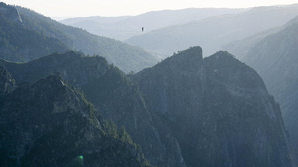 Moises Monterrubio walks a highline 1,600 feet in the air in Yosemite in June. The line stretched 2,800 feet, setting a record for Yosemite and California.