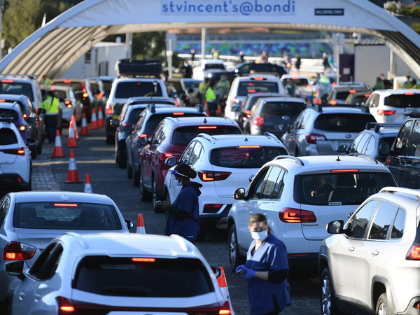 People line up in their cars to get tested for COVID-19 at a pop-up testing clinic at Bondi Beach in Sydney on June 25. Parts of Sydney will go into lockdown late Friday after a coronavirus outbreak in Australia's largest city continued to grow.