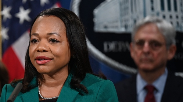 Assistant Attorney General Kristen Clarke for the Justice Department's Civil Rights Division speaks during a news conference Friday announcing a lawsuit against the state of Georgia for its new voting law. Attorney General Merrick Garland is at right.