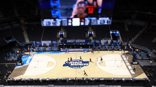 The March Madness logo on the court during the Sweet Sixteen round of the 2021 NCAA Men's Basketball Tournament in Indianapolis.