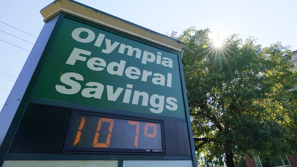 A display at an Olympia Federal Savings branch shows a temperature of 107 degrees Fahrenheit, Monday, June 28, 2021, in the early evening in Olympia, Wash.
