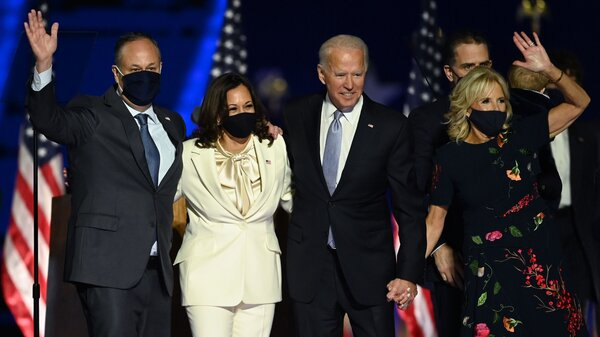 Incoming President Biden and Vice President Harris stand with their respective spouses Jill Biden and Doug Emhoff after delivering remarks in Wilmington, Del., on Nov. 7, the day the Democrats were declared the winners in the 2020 election.