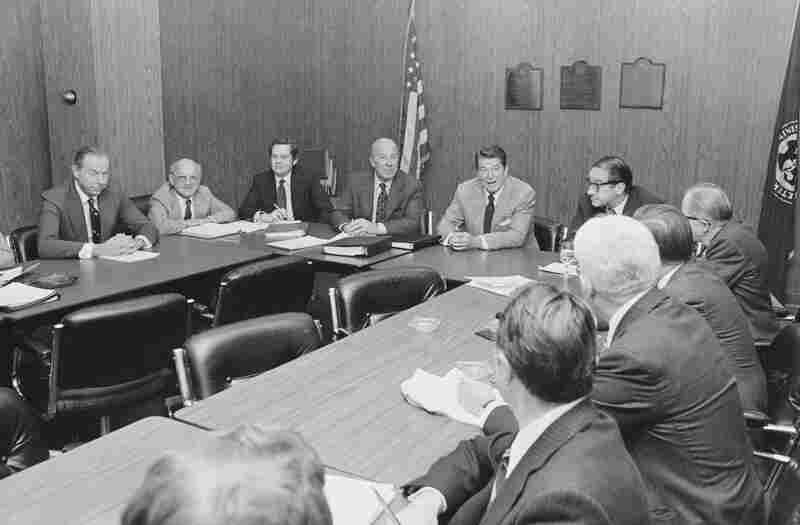 President-elect Ronald Reagan (fifth from left) meets with his top economic advisers, including Milton Friedman (second from left) to discuss his economic agenda.