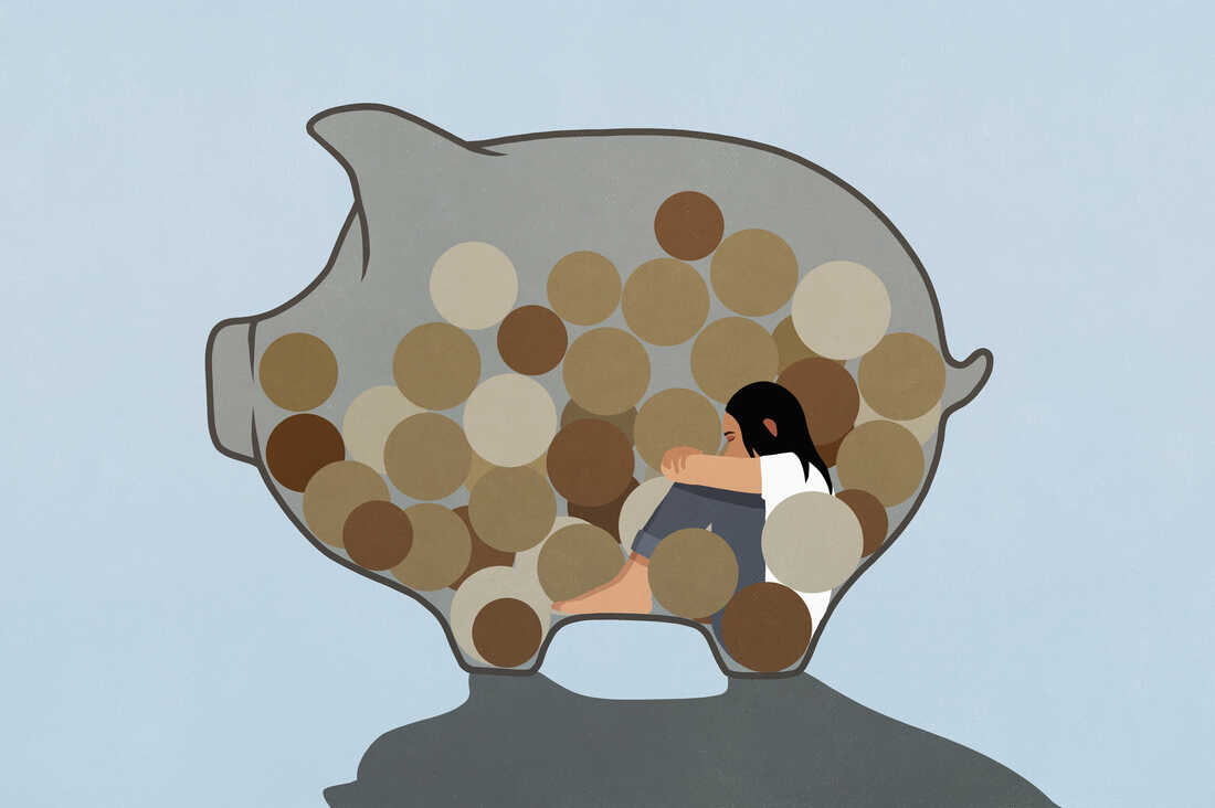 Illustration of a woman curled up inside a piggy bank, looking sad. The piggy bank is filled with coins. The piggy bank is set against a light blue backdrop.