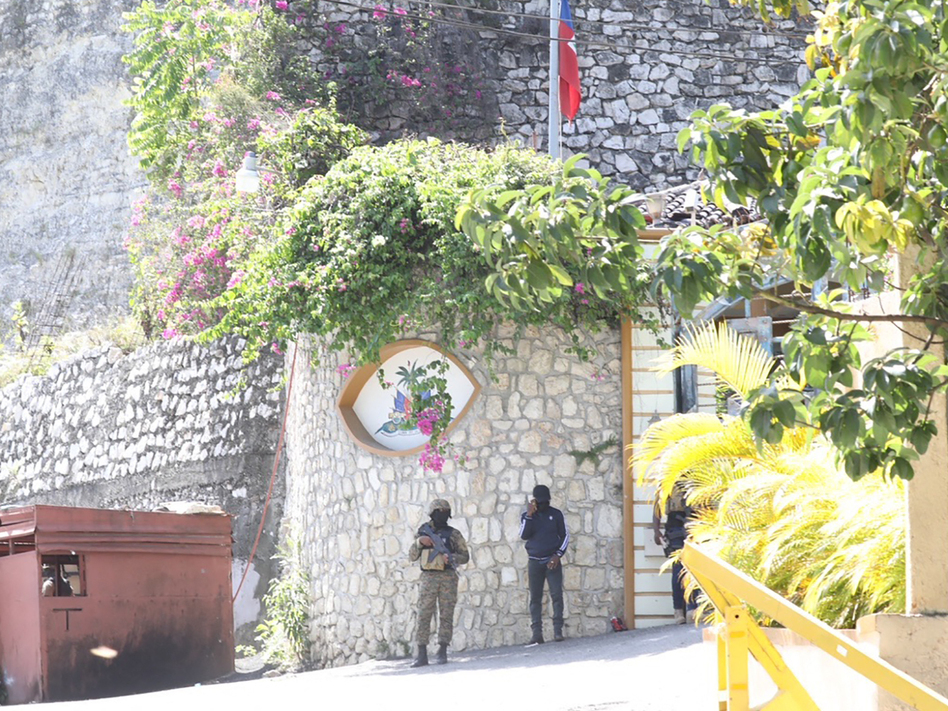 Members of the Haitian police and forensics patrol the area Wednesday as they look for evidence outside  the presidential residence in Port-au-Prince, Haiti. (Valerie Baeriswyl /AFP via Getty Images)