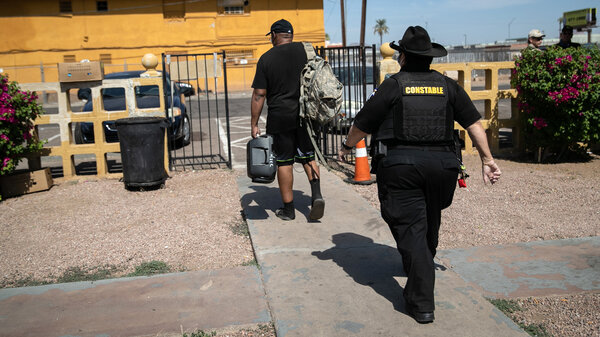 Maricopa County constable Darlene Martinez evicts a tenant on October 7, 2020 in Phoenix, Arizona. Thousands of court-ordered evictions continue nationwide despite a Centers for Disease Control (CDC) moratorium for renters impacted by the coronavirus pandemic.
