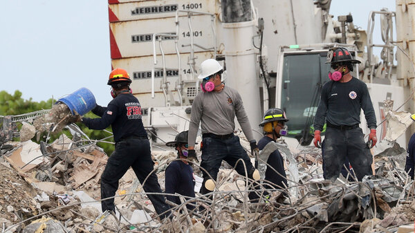 Search teams continue work Wednesday as efforts move into a recovery operation at the collapsed Champlain Towers South condo building in Surfside, Fla.
