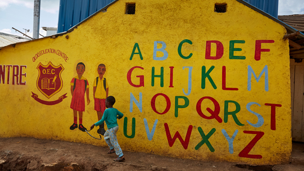 In his new book for young teenagers, Charles Kenny points out signs of global progress, including the growing number of kids in school. Above: The Oloo Education Center aims to provide an education to kids in Kibera, a poor community in Nairobi, Kenya. When you type