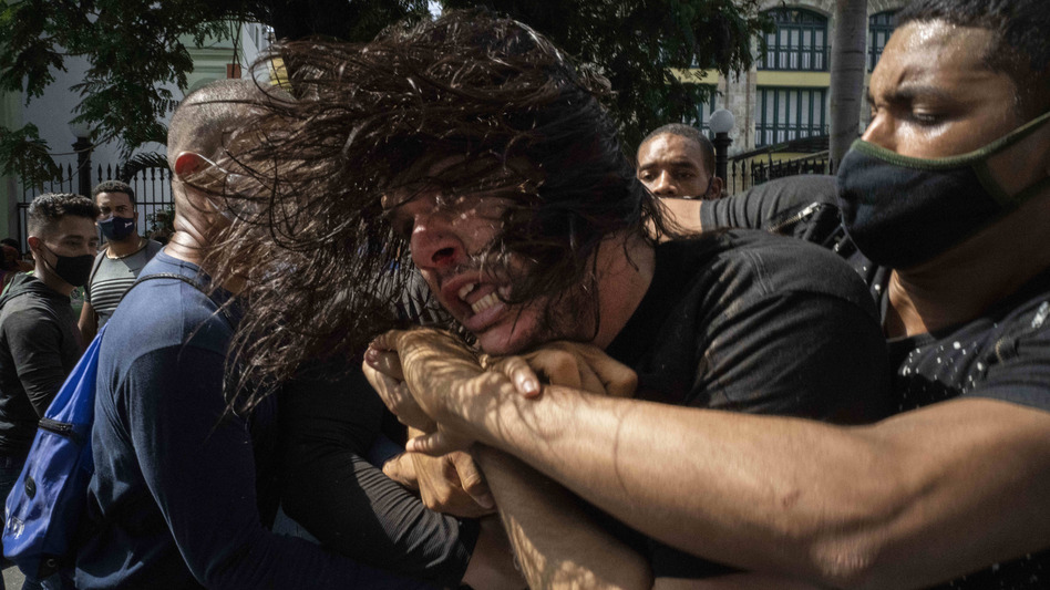 Plainclothes police detain an anti-government protester during a protest in Havana, Cuba, on Sunday. Hundreds of demonstrators went out to the streets in several cities in Cuba to protest against ongoing food shortages and high prices of foodstuffs. (Ramon Espinosa/AP)
