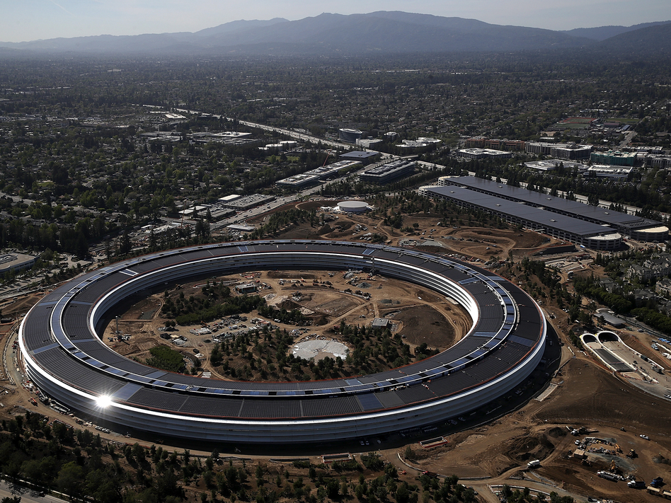 """Apple's massive"""" spaceship"""" campus designed to centralize work and foster collaboration in 2017 may have to make way for satellite offices and other remote work. (Justin Sullivan/Getty Images)"""