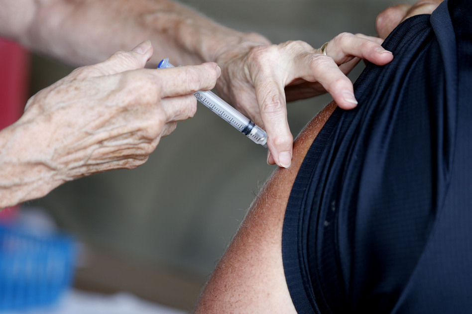 A man receives a COVID-19 vaccine at a clinic in Springfield, Mo., in June. Vaccination rates in southern Missouri are low, a factor officials say is helping drive what's now the nation's largest outbreak. (Nathan Papes/AP)