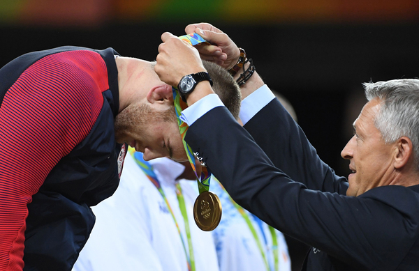 U.S. gold medalist Kyle Frederick Snyder receives his medal at the end of the men's 97-kilogram freestyle wrestling event during the 2016 Olympic Games in Rio de Janeiro.