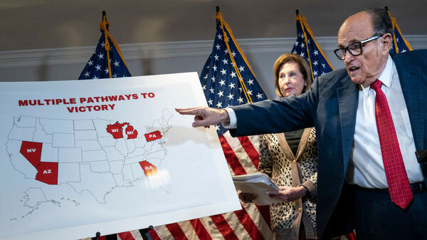 Rudy Giuliani points to a map as he speaks to the press about various lawsuits related to the 2020 election on Nov. 19, 2020. He and other Trump lawyers are now under scrutiny for their roles in promoting false claims of election fraud.