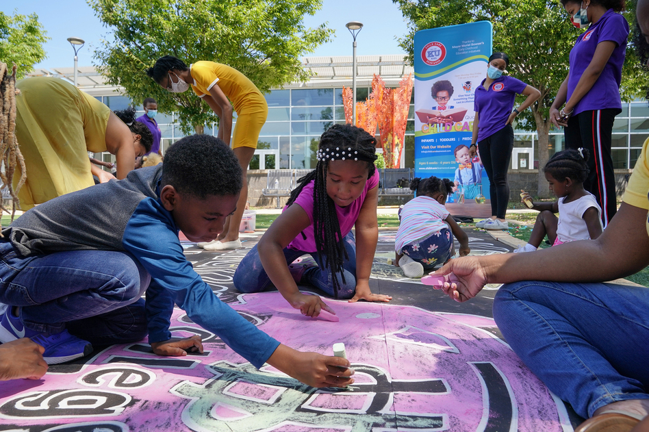 Children and teachers from the KU Kids Deanwood child care center in Washington, D.C., complete a mural in celebration of the launch of the child tax credit. (Jemal Countess/Getty Images for Community Change)