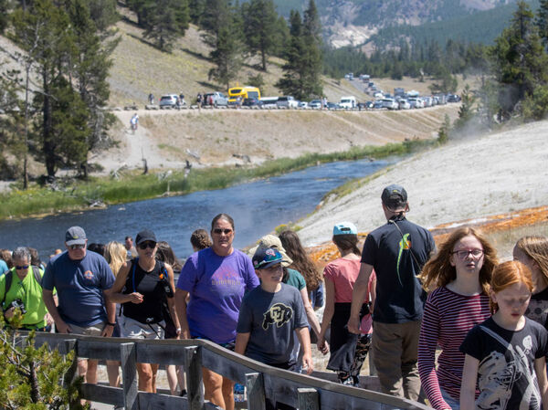 Tourists crowd into the Midway Geyser Basin at Yellowstone National Park in Wyoming on July 14. Yellowstone is one of many national parks seeing record numbers of visitors this summer, even as coronavirus cases are rising in many states.