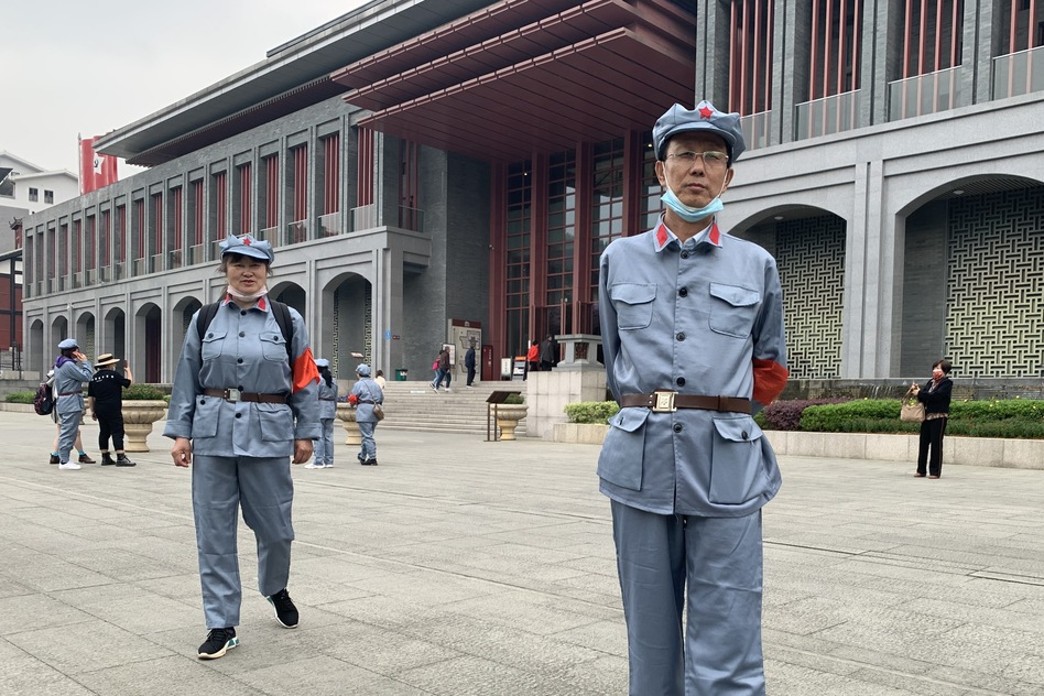 Tourist Wang Xiu visits Zunyi dressed up in a rented costume to look like a People's Liberation Army soldier who fought under Mao Zedong.