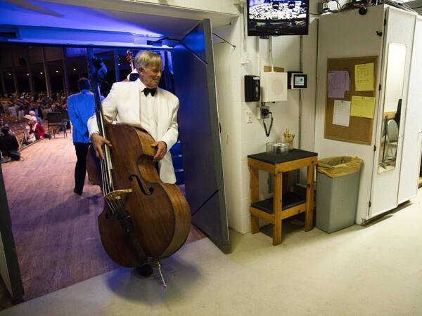 Lawrence Wolfe, assistant principal bassist of the Boston Symphony Orchestra, leaves the stage during during the July 10 concert at Tanglewood.