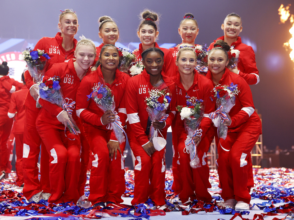 The women representing Team USA, including six team members and four alternates, pose last month after the U.S. Gymnastics Olympic trials in St. Louis. Kara Eaker, an alternate, has tested positive for the coronavirus, her gym says. (Jamie Squire/Getty Images)