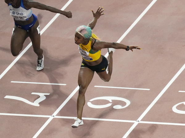 Jamaica's Shelly-Ann Fraser-Pryce, running at the World Athletics Championships in 2019, is going for her third Olympic gold in the 100 meter race.