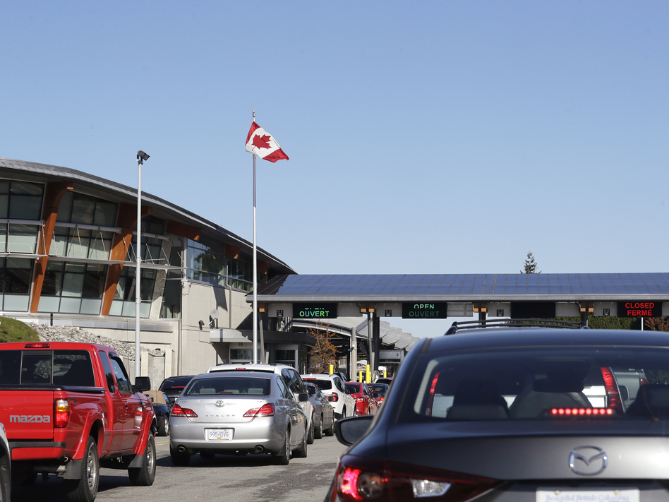 Traffic enters Canada from the United States at the Peace Arch Border Crossing in Blaine, Wash., in 2019. Vaccinated Americans will be able to travel to Canada, starting Aug. 9. (Elaine Thompson/AP)