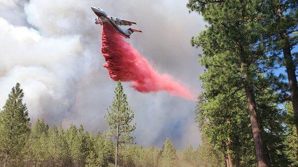 A tanker drops retardant over the Bootleg Fire in southern Oregon on Saturday.