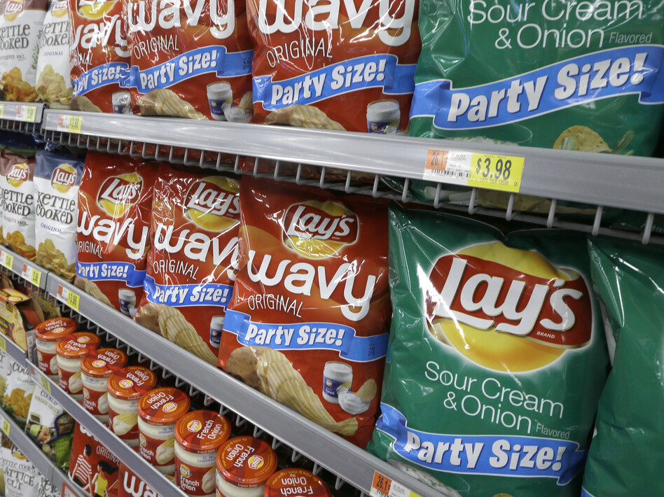 Frito-Lays workers at the Topeka, Kan., plant — one of 30 manufacturing plants the company operates in the U.S. — rejected a contract offer from the company earlier this month. They say they want better pay and working conditions. (Danny Johnston/AP)