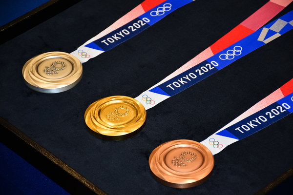Medal winners at the Tokyo Olympics will place them around their own necks due to safety protocols to prevent the spread of the coronavirus.