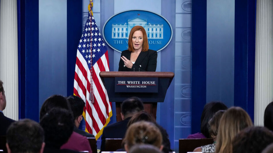 White House press secretary Jen Psaki speaks Tuesday at the daily briefing. She acknowledged a White House staffer had tested positive for the coronavirus despite being fully vaccinated. She said it wasn't the first breakthrough case. (Drew Angerer/Getty Images)